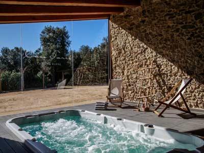 Foto Reserva habitacion con jacuzzi en Can Tarré